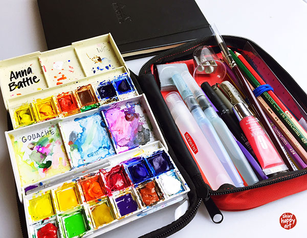 Contents of art travel kit on display